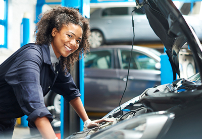 Smiling Woman Auto Mechanic